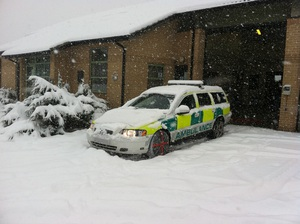 autosock fitted to ambulancecar in snow