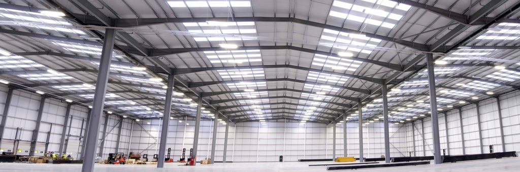 The 165000 square foot warehouse required an energy efficient lighting system that is fully compliant with new building regulations specified by the